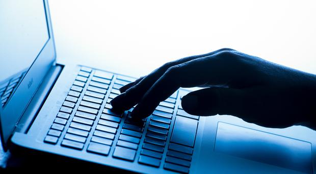 A man has been arrested over a cyber attack on a university (Dominic Lipinski/PA)