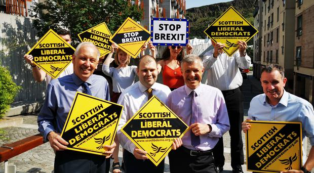 South Lanarkshire councillor Mark McGeever, front centre, at the announcement of his defection from the Tories to the Scottish Liberal Democrats (Tom Eden/PA)