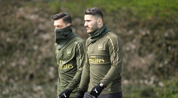 Sead Kolasinac and Mesut Ozil were targeted in London on Thursday (Adam Davy/PA)