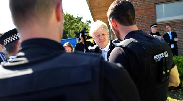 Boris Johnson pledged to boost police officer numbers (Dylan Martinez/PA)