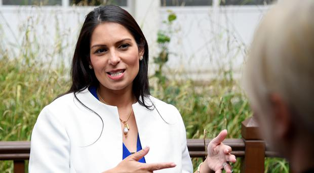 Home Secretary Priti Patel will head up a new board that will oversee the recruitment of 20,000 police officers (PA)