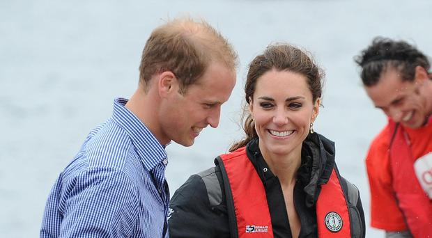 The Duke of and Duchess of Cambridge will compete against each other on sailing boats next month (PA)