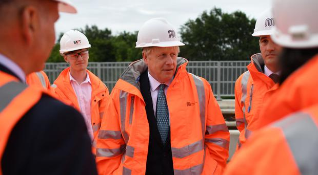 Prime Minister Boris Johnson meets engineering graduates on the site of an under-construction tramline in Stretford (Ben Stansall/PA)