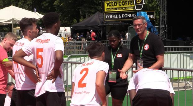 England men's manager Craig McManus talks to his players ahead of a game at the Homeless World Cup in Cardiff (PA)