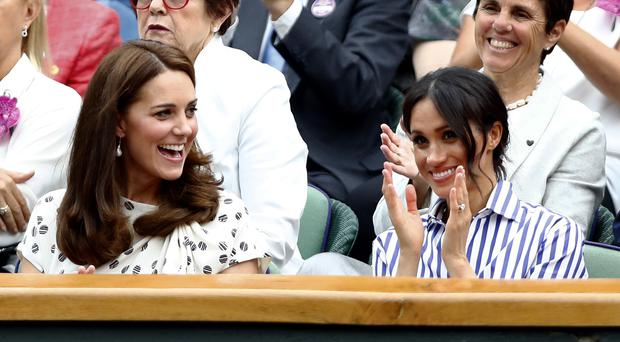 The Duchess of Cambridge and Duchess of Sussex at Wimbledon (PA)