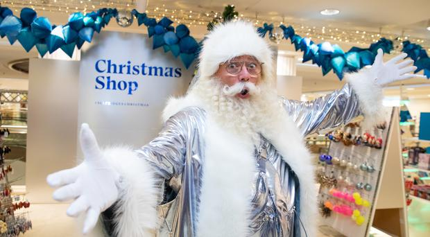 A man dressed as Future Fantasy Santa opens the Christmas shop at Selfridges in London (Aaron Chown/PA)