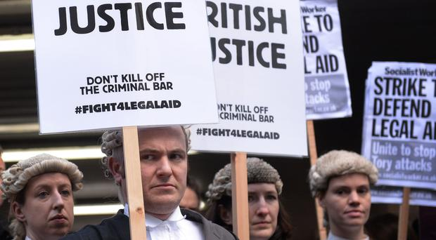 Barristers and solicitors outside Southwark Crown Court, London, during a nationwide strike against Government plans to cut fees as part of a bid to slash the legal aid budget (Stefan Rousseau/PA)
