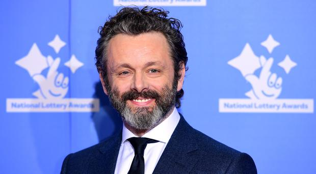 Michael Sheen has said he was given a different name at birth (Ian West/PA)