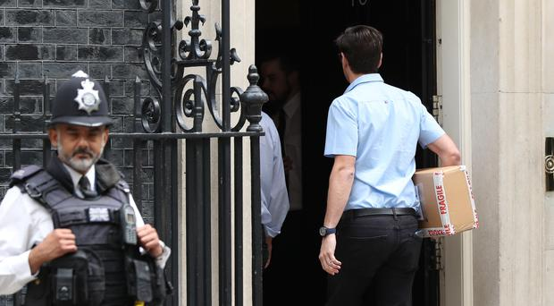 A package containing a diigital countdown clock is delivered to Number 10 (Yui Mok/PA)