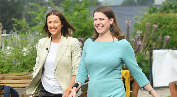 Welsh Liberal Democrat leader Jane Dodds and newly-elected Liberal Democrat leader Jo Swinson arrive at the Castle Hotel in Brecon, Wales, after the Liberal Democrats have won the Brecon and Radnorshire by-election (PA)