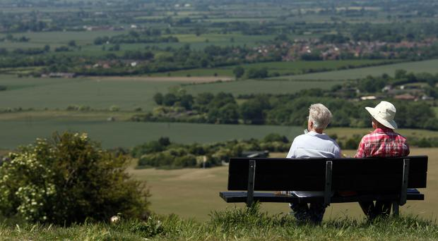 Socialising can help lower the risk of dementia, according to new research (Chris Radburn/PA)