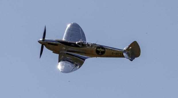 A restored MK IX Spitfire takes off from Goodwood aerodrome (Steve Parsons/PA)