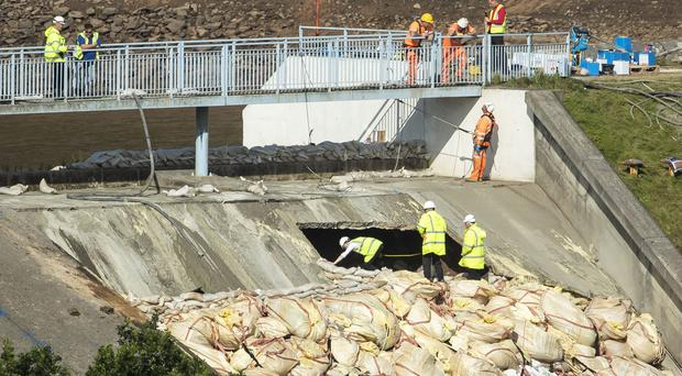 Workers continue to shore up the Toddbrook Reservoir dam (Danny Lawson/PA)