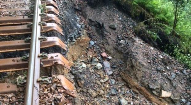The heavy rain caused part of the track's rock bedding to be swept away (Network Rail/PA)