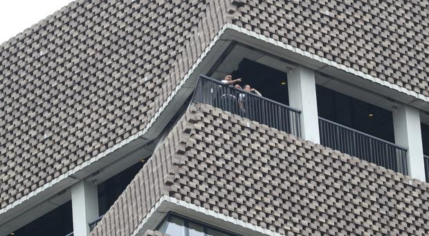 Police officers look out from the viewing platform at the Tate Modern (Yui Mok/PA)