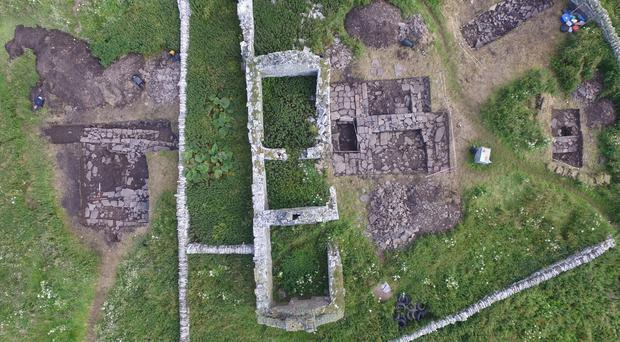 Trenches of the Norse hall lie to the left of the farmstead (Bobby Friel @Takethehighview/PA)