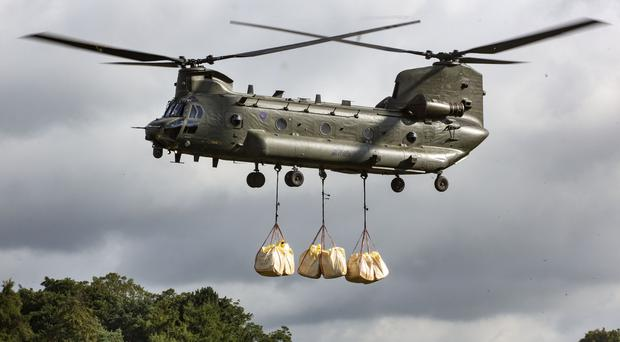 An RAF Chinook was drafted in to help again on Tuesday (Cpl Rob Travis/MoD/PA)