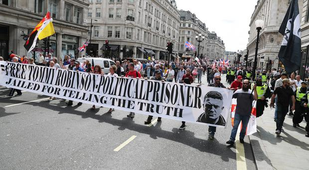 Tommy Robinson supporters in Oxford Street in London (Steve Parsons/PA)