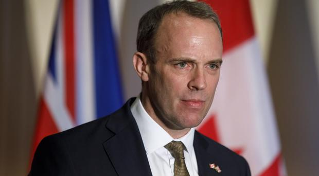 Foreign Secretary Dominic Raab at a news conference in Toronto (Cole Burston/The Canadian Press/AP)