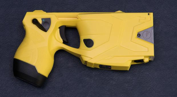Tasers carry a 50,000-volt electrical charge (Aaron Chown/PA)