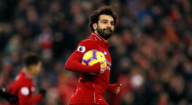 Liverpool's Mohamed Salah celebrates scoring his side's first goal of the game during the Premier League match at Anfield, Liverpool (Darren Staples/PA)