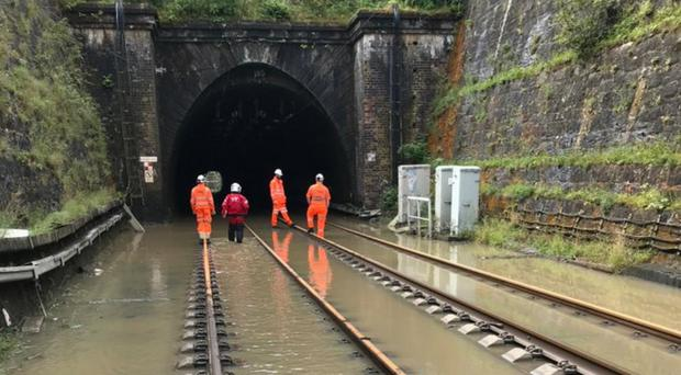 Scottish Fire and Rescue Service members made attempts to pump the water away from the Winchburgh Tunnel (ScotRail/PA)