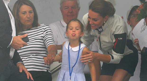 The Duchess of Cambridge with Princess Charlotte and Carole Middleton, left, at the prize-giving after the King's Cup regatta at Cowes on the Isle of Wight (Aaron Chown/PA)