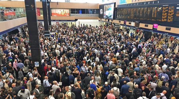A huge crowd of commuters inside Euston Station in London after all train lines were blocked due to a signalling fault (Cave of Pixels/PA)