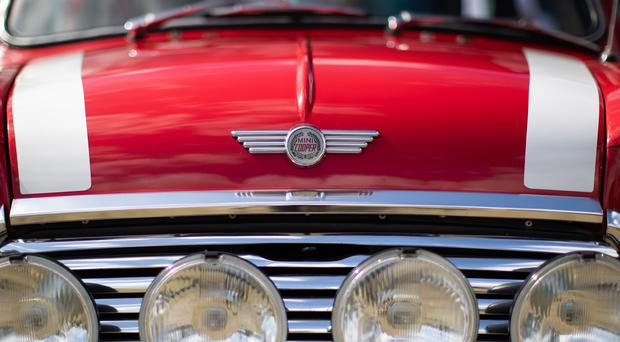 Minis across the generations were gathered together to mark the car's 60th anniversary (Aaron Chown/PA)