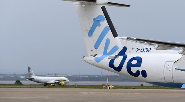 Passengers were ordered to remain on board a Flybe flight after landing in Manchester (Tim Goode/PA)