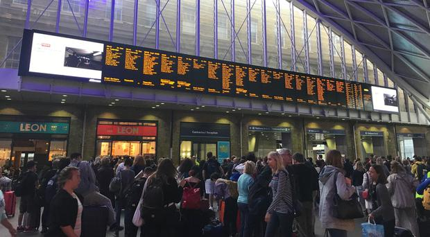 People waiting for trains at King's Cross station (Abbianca Makoni/PA)