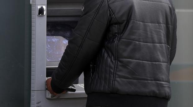 Money was stolen from an ATM machine inside a business premises.