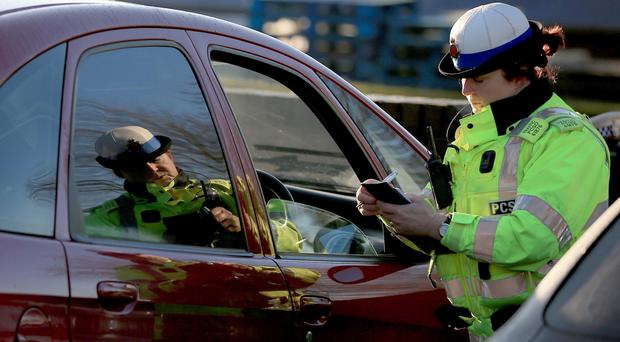 Punishments for using a hand-held phone behind the wheel were doubled in March 2017 (Peter Byrne/PA)