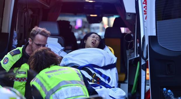 A women is taken by ambulance from Hotel CBD in Sydney, Australia(Dean Lewins/AAP/AP)