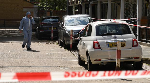 A forensic officer at the scene in Munster Square, Camden (Stefan Rousseau/PA)