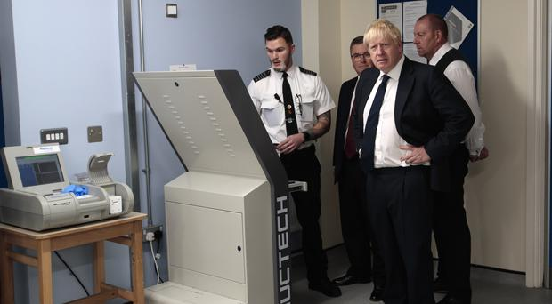 "Prime Minister Boris Johnson is shown a torso and body scanner by a member of prison staff during a visit to HMP Leeds after the announcement of �100 million investment to boost security and cut crime in prisons, with the warning that jails cannot become ""factories for making bad people worse""."
