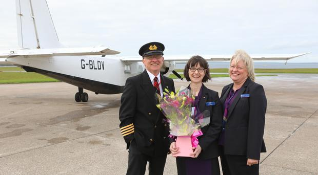 Captain Colin McAllister with Anne Rendall and Lois Canning (Loganair/PA)