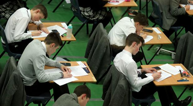 Undated file photo of students sitting an exam. Poor teenagers are 18 months behind their wealthier peers in their GCSEs as progress in closing the divide has come to a standstill, according to a report.