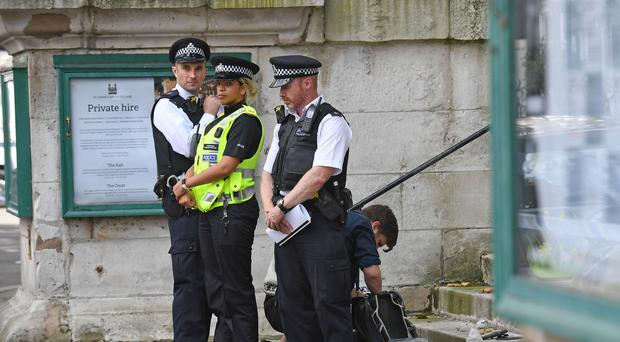 Investigators look at items outside St John's Smith Square church in Westminster (Stefan Rousseau/PA)