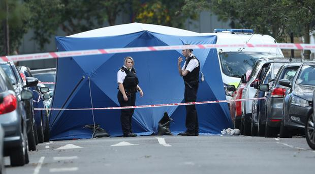 Police officers at the scene of a fatal stabbing in Lambeth (Yui Mok/PA)