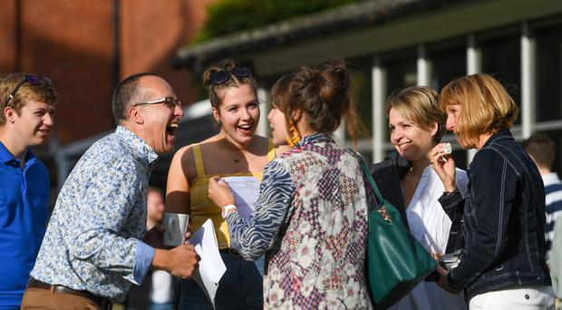 University places are being confirmed, the day after A-level results were published (Joe Giddens/PA)
