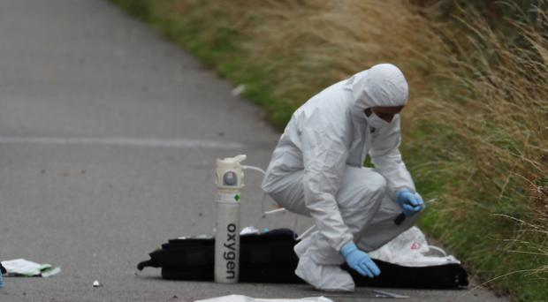 An investigator at the scene of the incident (Steve Parsons/PA)