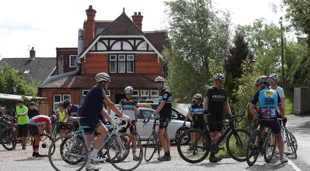 Cyclists at Velolife cafe and bicycle repair shop in Warren Row, Berkshire (Jonathan Brady/PA)