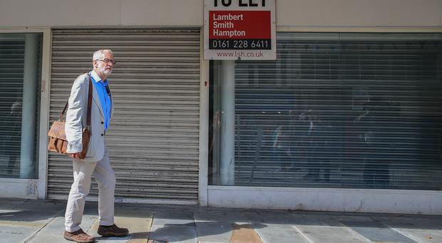 Jeremy Corbyn saw some of the boarded-up shops he hopes Labour policy could see reopen (Peter Byrne/PA)