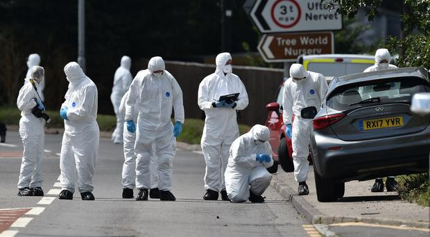 Police search the scene, where Thames Valley Police officer Pc Andrew Harper, 28, was killed (Ben Birchall/PA)