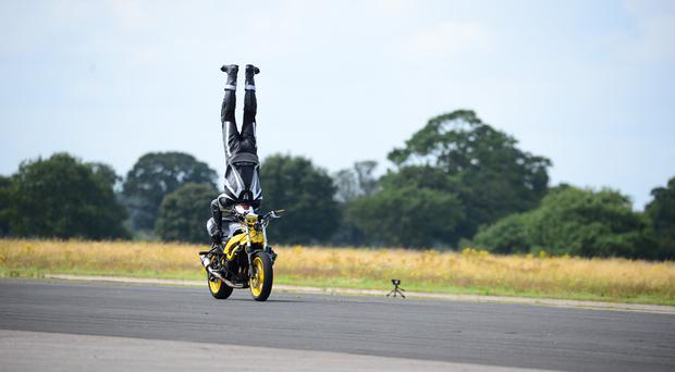 Marco George during a headstand on a motorbike(Harvey Brewster/Straightliners/PA)