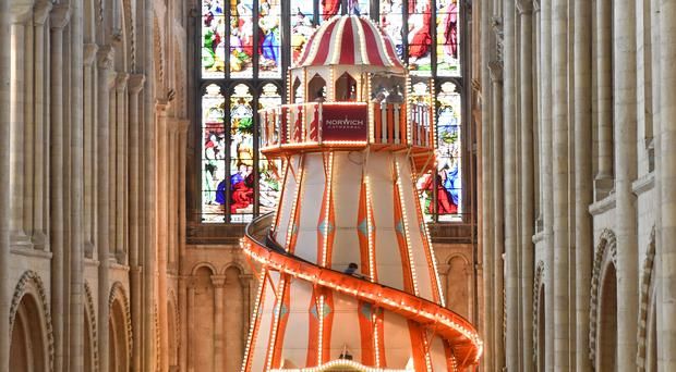 People view a helter skelter installed inside Norwich Cathedral as part of the Seeing It Differently project which aims to give people the chance to experience the Cathedral in an entirely new way and open up conversations about faith. (Joe Giddens/ PA)