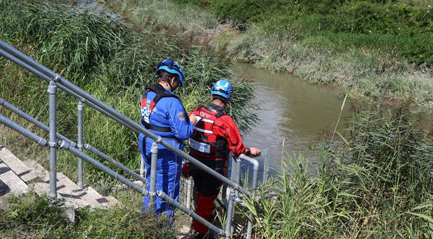 Members of the Coastguard monitor a section of the River Stour (Gareth Fuller/PA)