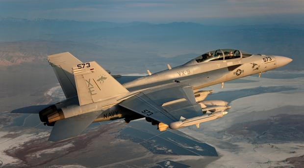 An EA-18G Growler by Boeing. Cobham, which supplies parts, is set for a £4 billion takeover, but the deal has been met with opposition by the founding family of the firm (Boeing/PA)