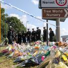 Police officers gather to pay their respects at the scene near Ufton Lane where Andrew Harper died (Andrew Matthews/PA)